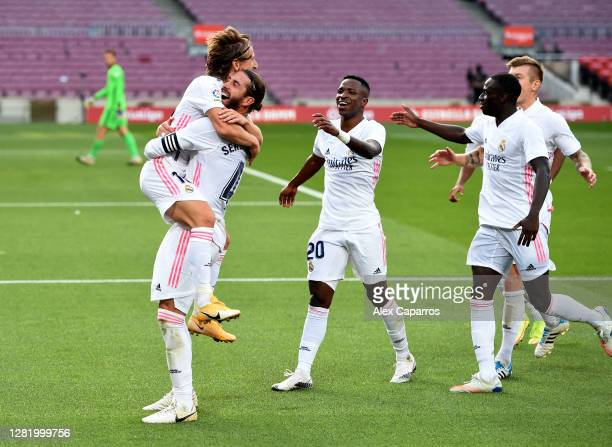Luka Modric of Real Madrid celebrates with his team after scoring his team's third goal during the La Liga Santander match between FC Barcelona and...