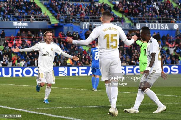 Luka Modric of Real Madrid celebrates with teammates after scoring his team's third goal during the La Liga match between Getafe CF and Real Madrid...