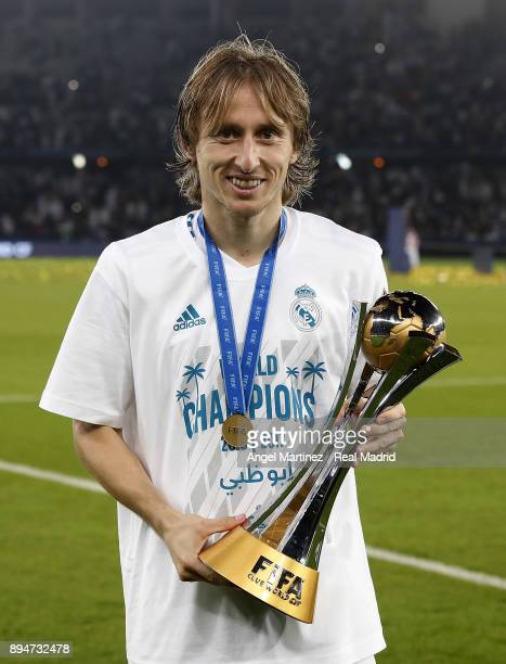 Luka Modric of Real Madrid celebrates with the trophy after the FIFA Club World Cup UAE 2017 Final match between Real Madrid CF and Gremio FBPA at...