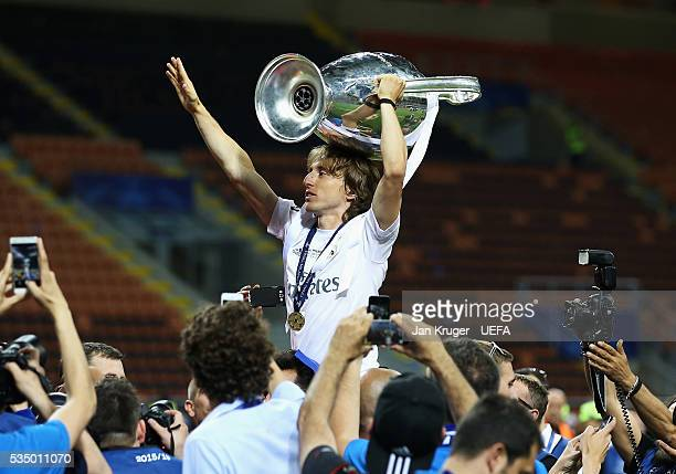 Luka Modric of Real Madrid celebrates with the trophy after the UEFA Champions League Final between Real Madrid and Club Atletico de Madrid at Stadio...
