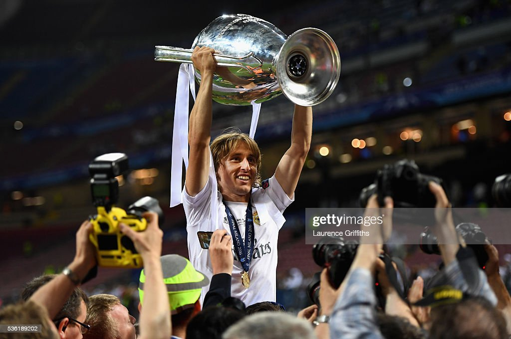 Luka Modric of Real Madrid celebrates with the trophy after victory in the UEFA Champions League Final match between Real Madrid and Club Atletico de Madrid at Stadio Giuseppe Meazza on May 28, 2016 in Milan, Italy.