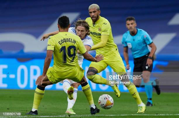 Luka Modric of Real Madrid CF and Francis Coquelin of Villarreal CF battle for the ball during the LaLiga Santander match between Real Madrid CF and...