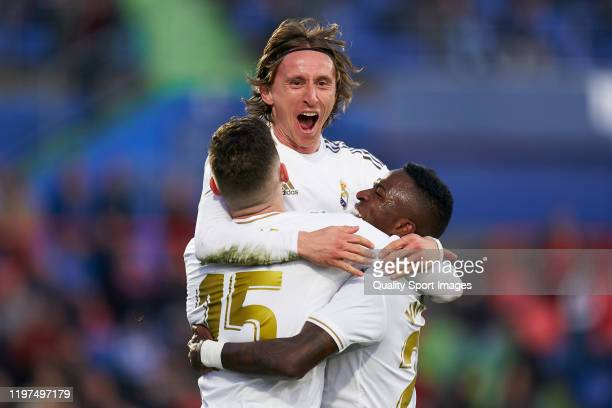 Luka Modric of Real Madrid CF celebrates after scoring his team's third goal with his teammates during the La Liga match between Getafe CF and Real...