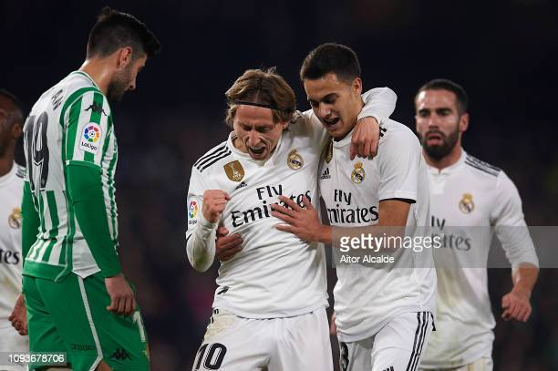 Luka Modric of Real Madrid CF celebrates after scoring with Sergio Reguilon of Real Madrid CF during the La Liga match between Real Betis Balompie...