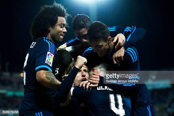 Luka Modric of Real Madrid CF celebrates scoring their second goal with teammates Marcelo Raphael Varane and Mateo Kovacic during the La Liga match...