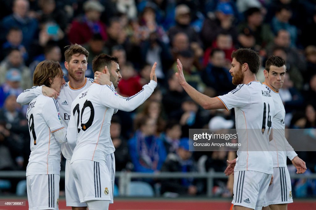 Luka Modric (L) of Real Madrid CF celebrates scoring their third goal with teammates Sergio Ramos (2ndL), Jese Rodriguez (3dL), Xabi Alonso (2ndR) and Gareth Bale (R) during the La Liga match between Getafe CF and Real Madrid CF at Coliseum Alfonso Perez on February 16, 2014 in Getafe, Spain.