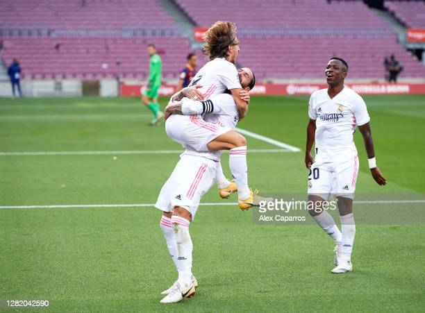 Luka Modric of Real Madrid CF celebrates with Sergio Ramos and Vinicius Junior after scoring his sides third goal during the La Liga Santander match...