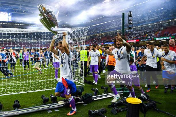 Luka Modric of Real Madrid CF celebrates with the trophy after the UEFA Champions League Final between Juventus and Real Madrid at National Stadium...