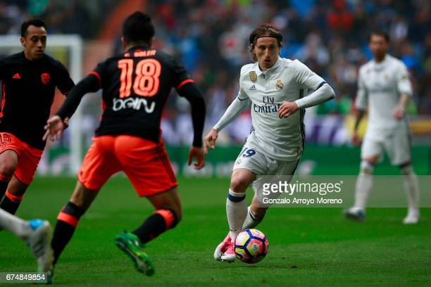 Luka Modric of Real Madrid CF competes for the ball with Carlos Soler of Valencia CF during the La Liga match between Real Madrid CF and Valencia CF...