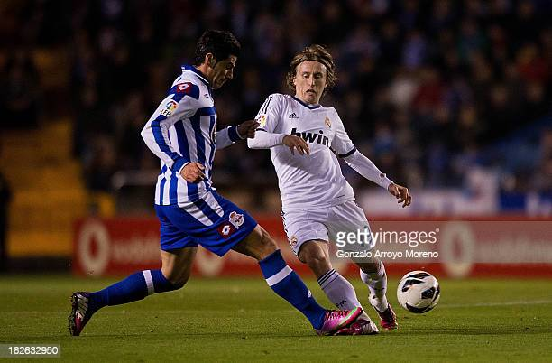 Luka Modric of Real Madrid CF competes for the ball with Ivan Sanchez Rico alias Riki of RC Deportivo La Coruna during the La Liga match between RC...