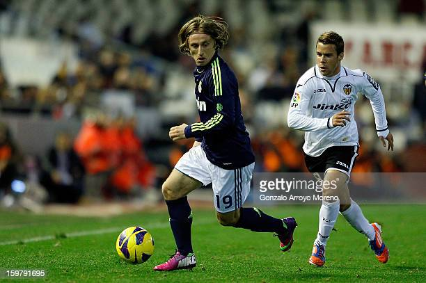 Luka Modric of Real Madrid CF competes for the ball with Pablo Hernandez of Valencia CF during the La Liga match between Valencia CF and Real Madrid...