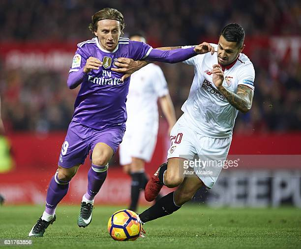 Luka Modric of Real Madrid CF competes for the ball with Victor Machin Perez 'Vitolo' of Sevilla FC during the La Liga match between Sevilla FC and...