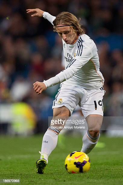 Luka Modric of Real Madrid CF controls the ball during the La Liga match between Real Madrid CF and Sevilla FC at Estadio Santiago Bernabeu on...