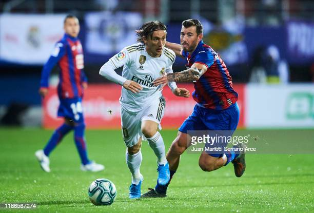 Luka Modric of Real Madrid CF duels for the ball with Sergi Enrich of SD Eibar during the Liga match between SD Eibar SAD and Real Madrid CF at...