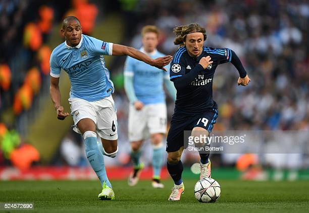 Luka Modric of Real Madrid CF goes past Fernando of Manchester City during the UEFA Champions League Semi Final first leg match between Manchester...