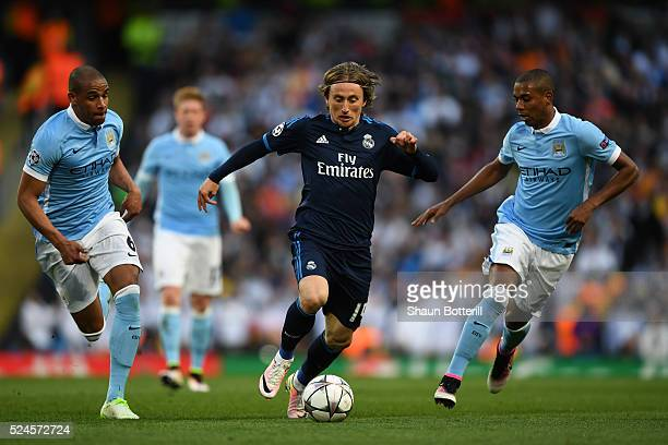 Luka Modric of Real Madrid CF is closed down by Fernando and Fernandinho of Manchester City during the UEFA Champions League Semi Final first leg...