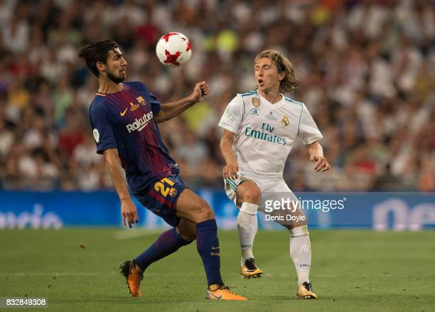 Luka Modric of Real Madrid CF lobs the ball over the head of Andre Gomes of FC Barcelona during the Supercopa de Espana Final 2nd Leg match between...