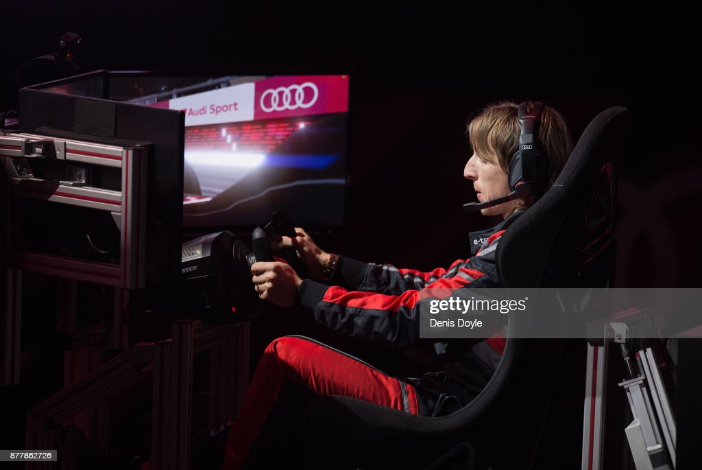 Luka Modric of Real Madrid CF races in his simulated Formula-e car during a race with his teammates during the Audi Handover Sponsorship deal with Real Madrid at the Ciudad Deportivo training grounds on November 23, 2017 in Madrid, Spain.