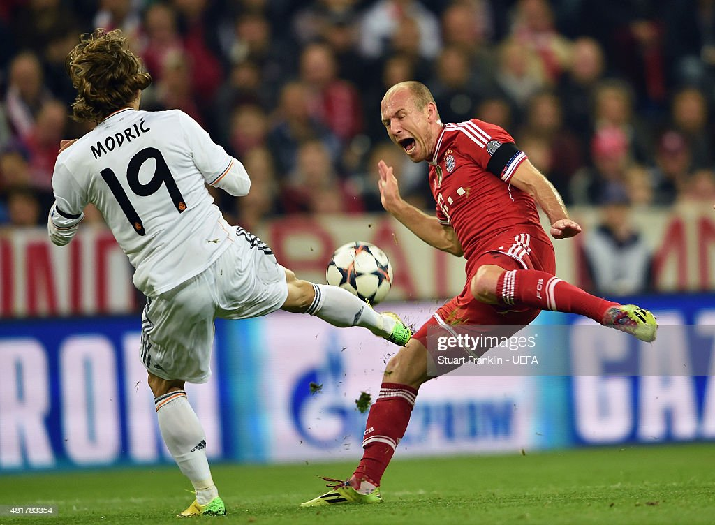 Luka Modric of Real Madrid challenges Arjen Robben of Bayern Munich during the UEFA Champions League Semi Final second leg match between FC Bayern Muenchen and Real Madrid at Allianz Arena on April 29, 2014 in Munich, Germany.