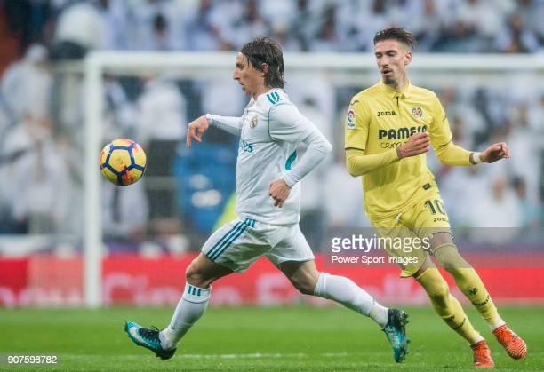 Luka Modric of Real Madrid competes for the balding Samuel Castillejo Azuaga Samu Castillejo of Villarreal CF during the La Liga 201718 match between...