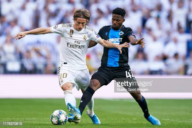Luka Modric of Real Madrid competes for the ball with Emmanuel Bonaventure of Club Brugge during the UEFA Champions League group A match between Real...