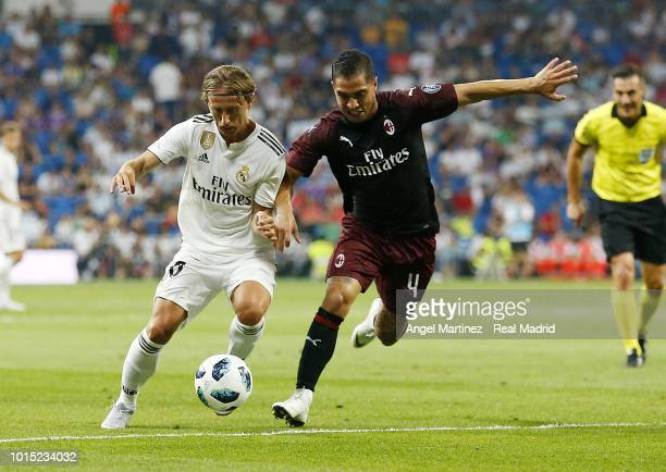 Luka Modric of Real Madrid competes for the ball with Jose Mauri of AC Milan during the Trofeo Santiago Bernabeu match between Real Madrid and AC...