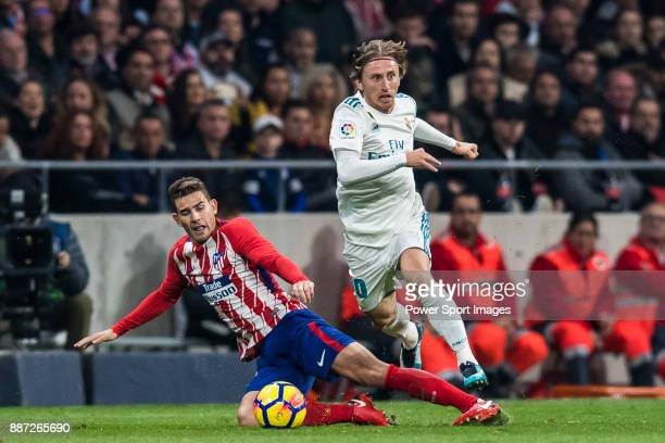 Luka Modric of Real Madrid competes for the ball with Lucas Hernandez of Atletico de Madrid during the La Liga 201718 match between Atletico de...