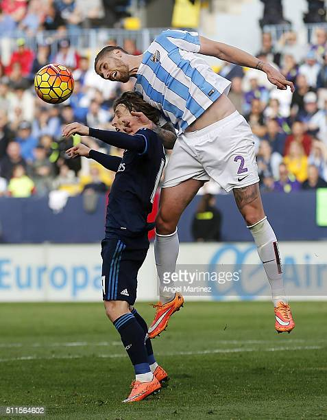 Luka Modric of Real Madrid competes for the ball with Raul Albentosa of Malaga CF during the La Liga match between Malaga CF and Real Madrid CF at La...
