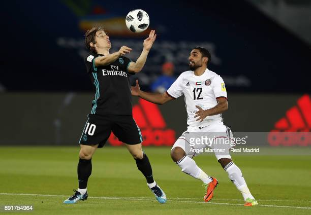 Luka Modric of Real Madrid competes for the ball with Salim Rashid of Al Jazira during the FIFA Club World Cup UAE 2017 semifinal match between Al...