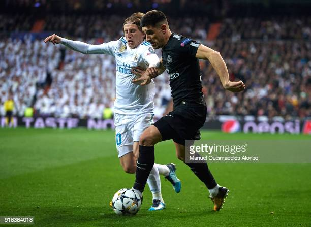 Luka Modric of Real Madrid competes for the ball with Yuri Berchiche of Paris SaintGermain during the UEFA Champions League Round of 16 First Leg...