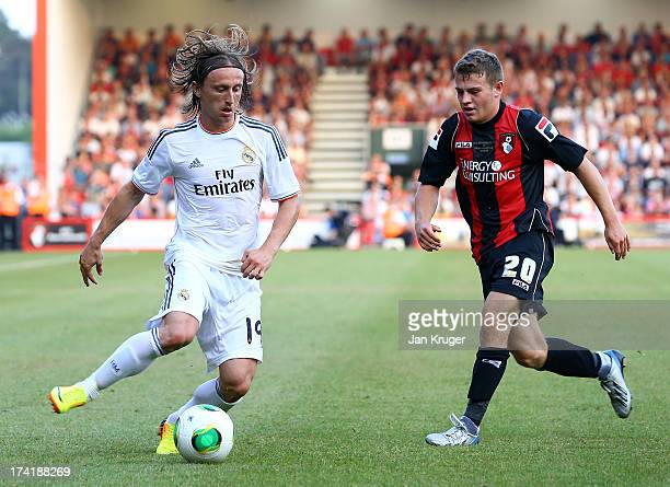 Luka Modric of Real Madrid controls the ball from Ryan Fraser of AFC Bournemouth during a pre season friendly match between AFC Bournemouth and Real...