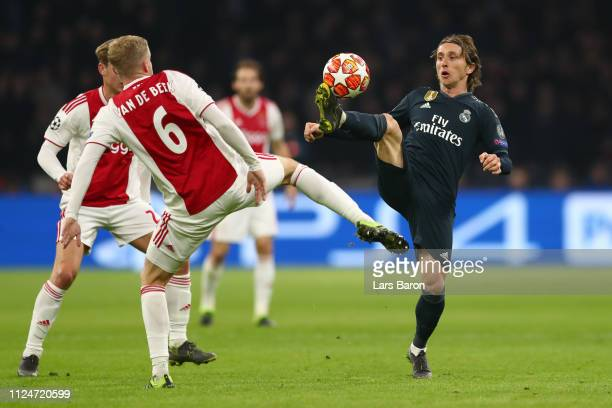 Luka Modric of Real Madrid controls the ball while under pressure from Donny van de Beek of Ajax during the UEFA Champions League Round of 16 First...