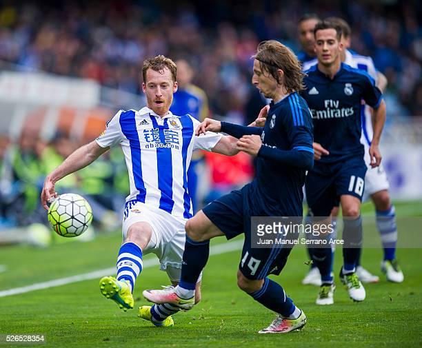 Luka Modric of Real Madrid duels for the ball with David Zurutuza of Real Sociedad during the La Liga match between Real Sociedad de Futbol and Real...