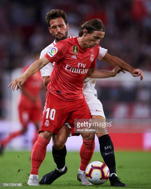 Luka Modric of Real Madrid duels for the ball with Franco Vazquez of Sevilla FC during the La Liga match between Sevilla FC and Real Madrid CF at...