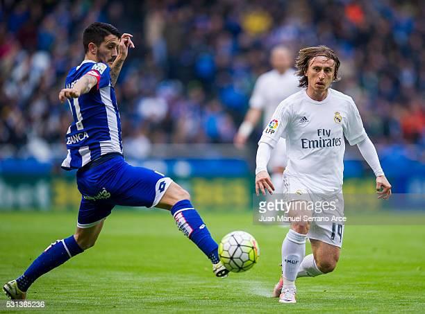 Luka Modric of Real Madrid duels for the ball with Luis Alberto Romero of RC Deportivo La Coruna during the La Liga match between RC Deportivo La...