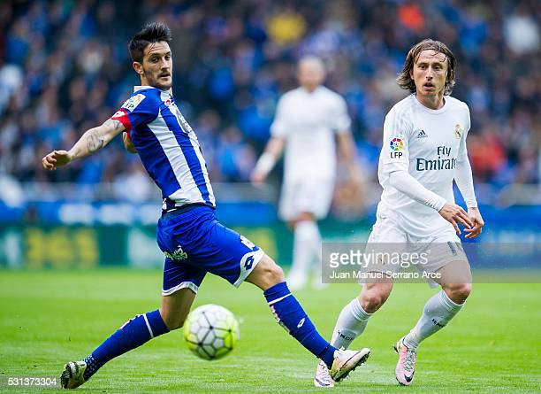 Luka Modric of Real Madrid duels for the ball with Luis Alberto Romero of RC Deportivo La Coruna during the La Liga match between RC Deportivo La...