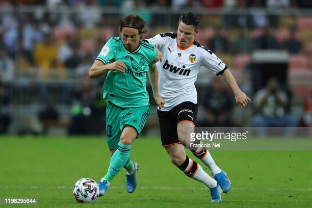 Luka Modric of Real Madrid holds off Kevin Gameiro of Valencia during the Supercopa de Espana SemiFinal match between Valencia CF and Real Madrid at...