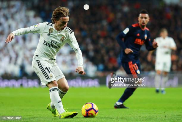 Luka Modric of Real Madrid holds passes the ball during the La Liga match between Real Madrid CF and Valencia CF at Estadio Santiago Bernabeu on...