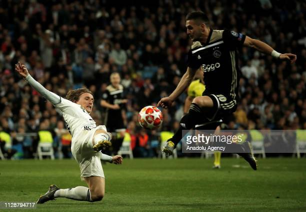 Luka Modric of Real Madrid in action against Dusan Tadic of Ajax during UEFA Champions League Round of 16 second leg match between Real Madrid and...