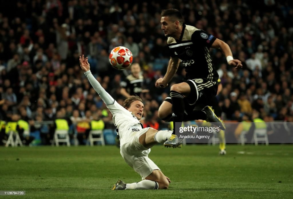 Luka Modric Of Real Madrid In Action Against Dusan Tadic