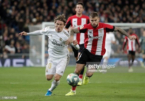 Luka Modric of Real Madrid in action against Inigo Martine of Athletic de Bilbao during the La Liga match between Real Madrid and Athletic de Bilbao...