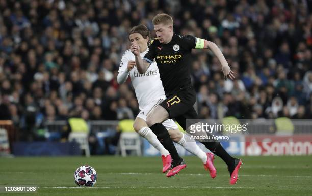 Luka Modric of Real Madrid in action against Kevin de Bruyne of Manchester City during the UEFA Champions League round of 16 first leg soccer match...