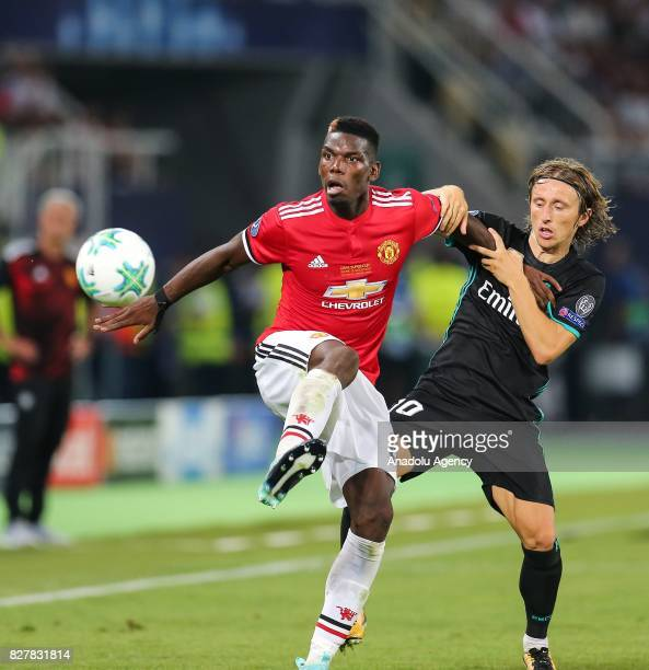 Luka Modric of Real Madrid in action against Paul Pogba of Manchester United during the UEFA Super Cup final between Real Madrid and Manchester...