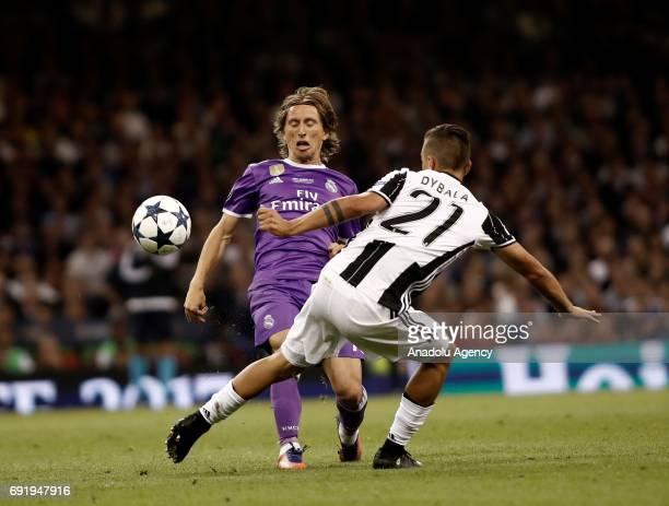 Luka Modric of Real Madrid in action against Paulo Dybala of Juventus during UEFA Champions League Final soccer match between Juventus and Real...
