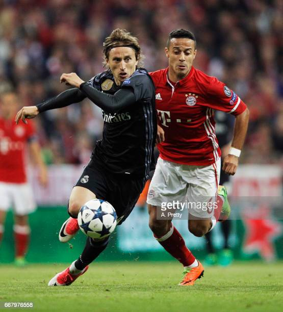 Luka Modric of Real Madrid is challenged by Thiago Alcantara of Bayern Munich during the UEFA Champions League Quarter Final first leg match between...