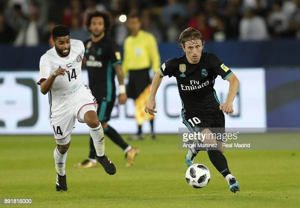 Luka Modric of Real Madrid is chased by Eissa Mohamed of Al Jazira during the FIFA Club World Cup UAE 2017 semifinal match between Al Jazira and Real...