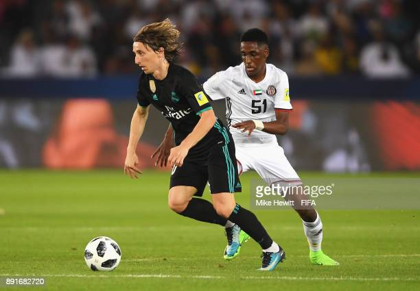 Luka Modric of Real Madrid is put under pressure by Yaqoub Al Hosani of Al Jazira during the FIFA Club World Cup UAE 2017 semifinal match between Al...