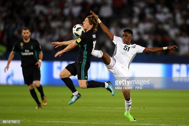 Luka Modric of Real Madrid is put under pressure from Khalifa Mubarak of Al Jazira during the FIFA Club World Cup UAE 2017 semifinal match between Al...