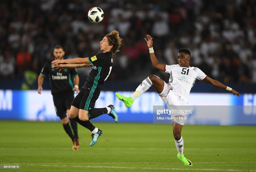 Luka Modric of Real Madrid is put under pressure from Khalifa Mubarak of Al Jazira during the FIFA Club World Cup UAE 2017 semi-final match between Al Jazira and Real Madrid on December 13, 2017 at the Zayed Sports City Stadium in Abu Dhabi, United Arab Emirates.