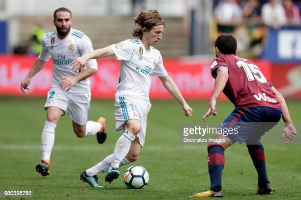 Luka Modric of Real Madrid Jose Angel of SD Eibar during the La Liga Santander match between Eibar v Real Madrid at the Estadio Municipal de Ipurua...